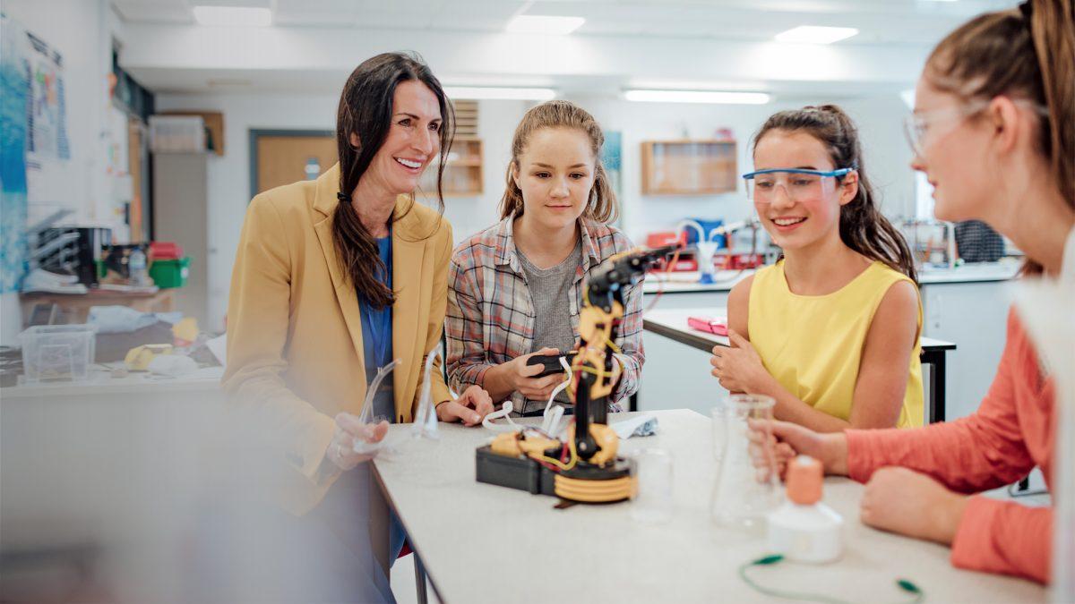 three students and teacher at cheltenham ladies college