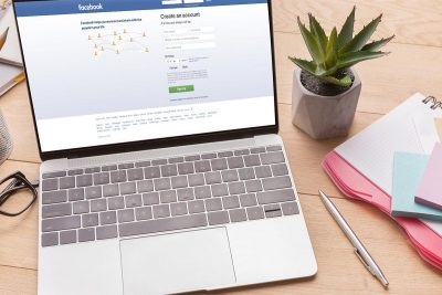 Laptop with homepage of facebook open