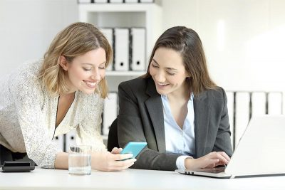 two women looking at phone